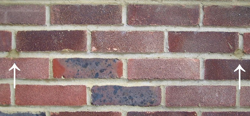 Cavity Wall Insulation Grants - Drill marks filled with mortar after cavity wall insulation was retro-fitted to a house